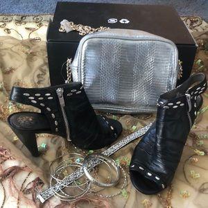 Black leather Vince Camuto mid heels.